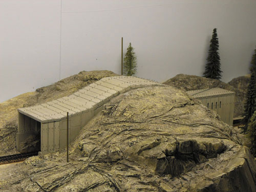 Close up photo of the Donner Summit HO scale Tunnel 7 with scratch made foam rock work.