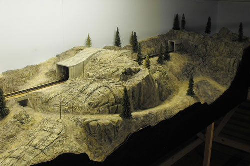 Overview of Donner Summit tunnel 7 scratch-built in HO scale with foam rock faces and scenery.
