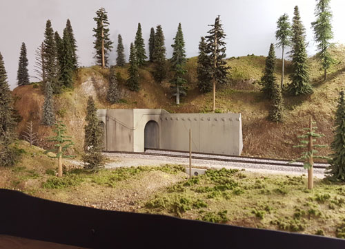 Photo of Tunnels 13 and 42 high above the east end of Donner Lake.
