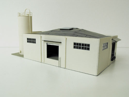 Custom built Campbell's Scale Models HO concrete wall warehouse.