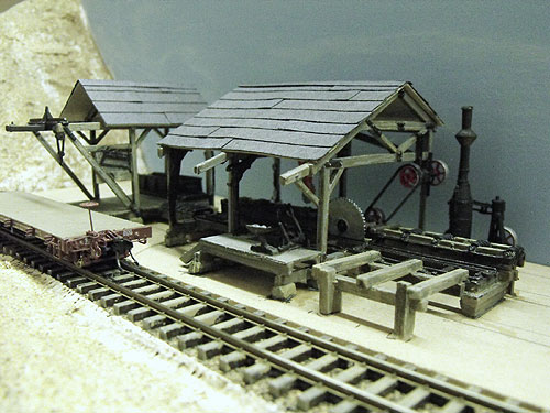 Woodland Scenic's HO scale Tie & Plank Mill shown during assembly and layout placement testing.