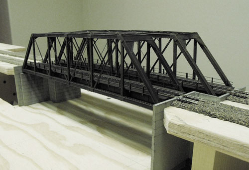 N Scale Central Valley Models Works 150 foot Pratt truss bridge kits assembled and placed on the layout.