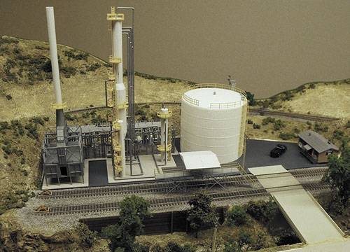 Completed and painted N scale oil refinery facility using Walthers, Train Cat and Model Power assembled models.